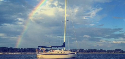 sailboat under rainbow